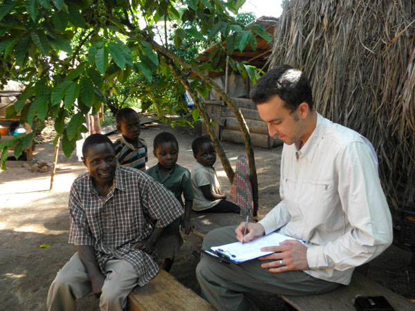 Sean Kearney, then a UC Davis graduate student, interviews farmers in Uganda for a project with Dr. Kate Scow during the Horticulture Innovation Lab's first five years.