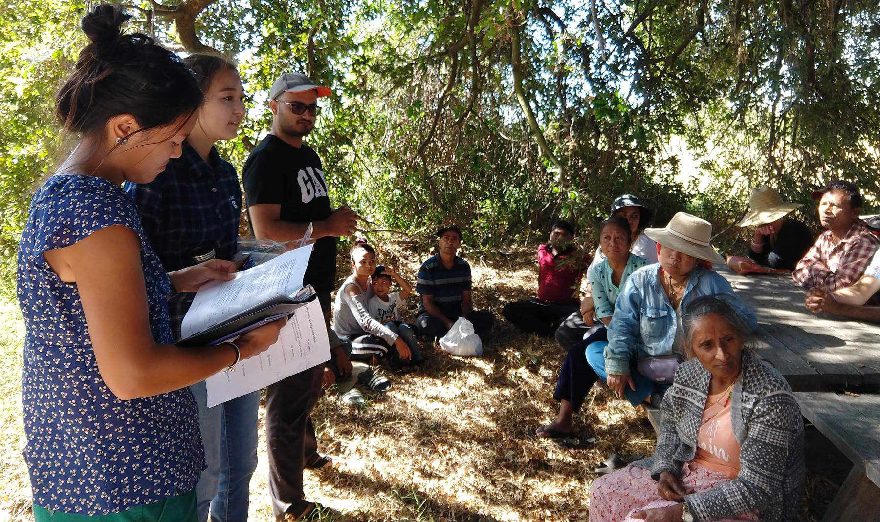 UC Davis students speak to refugee farmers at IRC New Roots farm in Sacramento