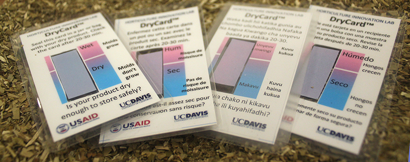 """Is your product dry enough to store safely?"" UC Davis logo, four DryCards in English, Swahili, French and Spanish"