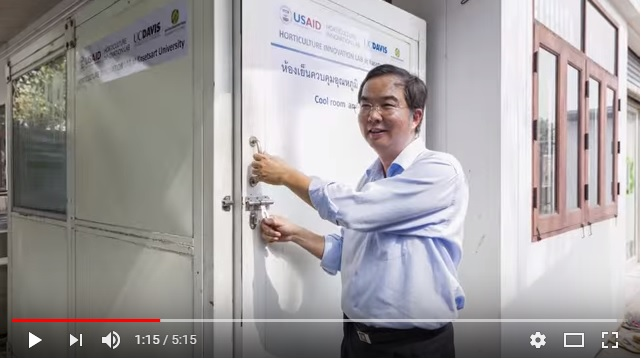 "Poonpipope ""Poon"" Kasemsap opens door to cold room with USAID Hortiulture Innovation Lab logos on it"