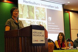 "Lee at podium in front of a screen that reads ""Horticulture Innovation Lab"""