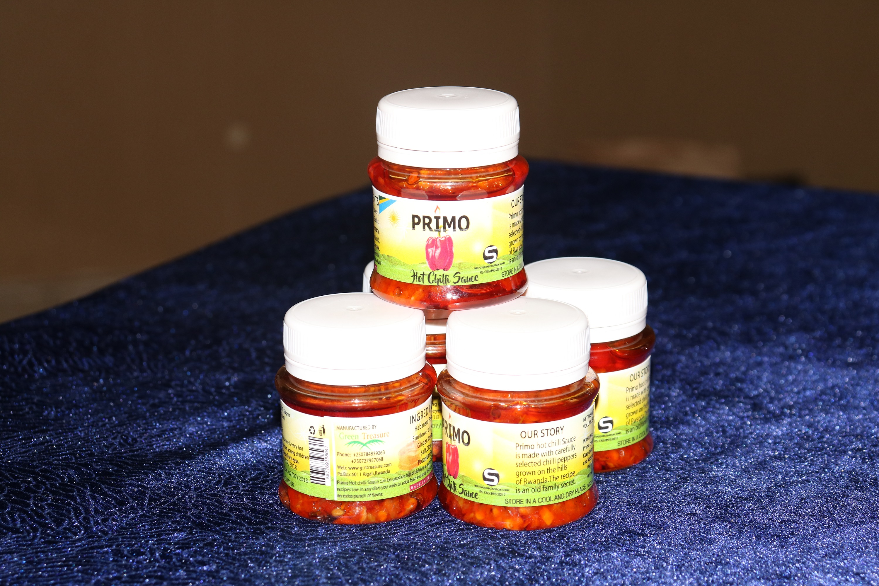 Several jars of Primo Chili Sauce
