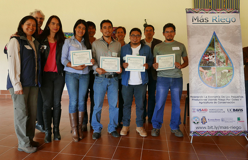 Group, smiling, with certificates by MasRiego banner