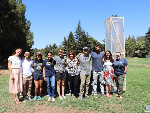 UC Davis group photo with chimney solar dryer