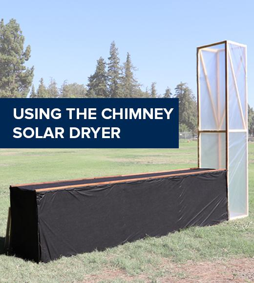 """Using the chimney solar dryer"" on an image of the chimney solar dryer in a sunny field"