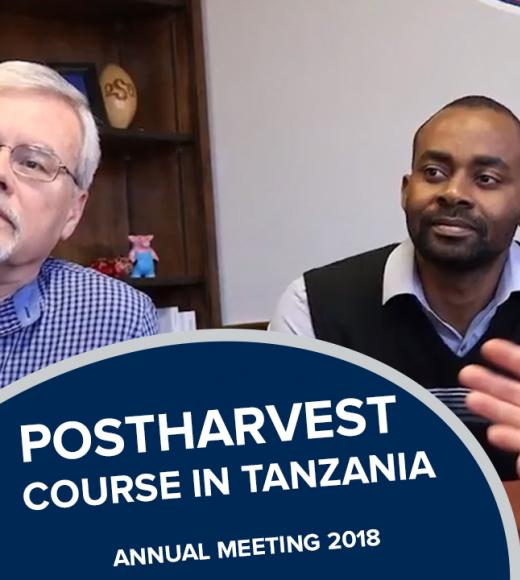 """Postharvest course in tanzania, annual meeting 2018"" text over Majubwa and colleague looking at a computer"