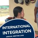 """International integration, annual meeting 2018"" on a photo of graduate students conducting an interview"