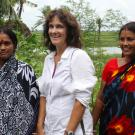 Beth Mitcham stands smiling with three women in saris