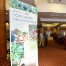 Hotel ballroom with Horticulture Innovation Lab poster in foreground