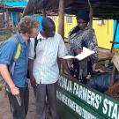 Consulting with a farmer during a previous Trellis Fund project led by the Mwino Group in Uganda, with Alex Greenspan of UC Davis.